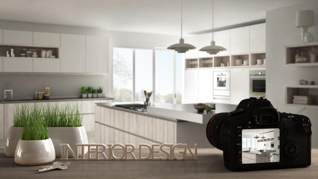 macchina fotografica sul set di un servizio fotografico di architettura che inquadra una cucina